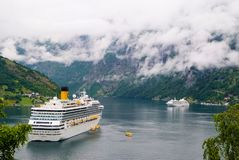 Geiranger, Norway - January 25, 2010: passenger liner docked in port. Cruise ship in norwegian fjord. Travel destination, tourism. Adventure discovery, journey stock images