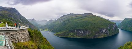 Geiranger fjord in Norway. Geiranger, Norway - September 5, 2017: Geiranger is a 15-kilometre 9.3 mi long branch off of the Sunnylvsfjorden, which is a branch Stock Photos