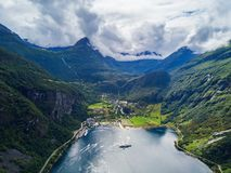 Geiranger at Geirangerfjord, Norway. Geiranger is a small tourist village in Sunnmore region of Norway. Geiranger lies at the Geirangerfjord Stock Photography