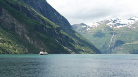 Geirangerfjord from the ferry. View of the Norwegian Geirangerfjord and the ferry coming from the opposite direction stock footage