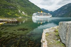Geirangerfjord-steamship. Steamship anchoring in Geiranger fjord nearby the famous Seven sisters waterfall Royalty Free Stock Photo