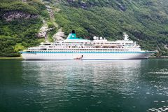 A cruise ship in Geirangerfjord in Norway. The Geiranger Fjord is one of Norway`s most visited tourist landmarks. It is enrolled on the UNESCO World Heritage royalty free stock photos