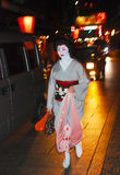 Geisha. KYOTO,JAPAN-APRIL 4:Unidentified Geisha walking by an old street at night on April 4,2010 in Gion district,Kyoto,Japan.Geisha are professional Royalty Free Stock Image
