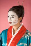 Geisha. Asian female with geisha style face paint in yukata (kimono Royalty Free Stock Photo