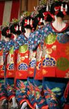 Geisha. Girls walking in a row, Kyoto, Japan