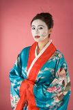 Geisha Asian woman facepaint in yukata kimono. Asian female with geisha style face paint in yukata (kimono Stock Image