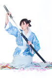 Geisha in blue kimono with katana Stock Photography