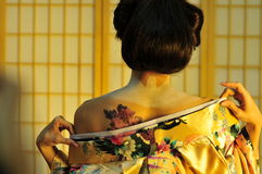 Geisha changing Royalty Free Stock Photos