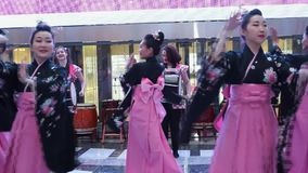 Geisha dance. Moscow, Russia - March 24, 2017: group of japanese geishas in traditional japanese kimono dancing in a mall Riviera. The performance dedicated to stock video footage