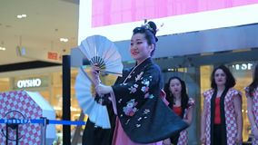 Geisha dance. Moscow, Russia - March 24, 2017: group of japanese geishas in traditional japanese kimono dancing in a mall Riviera. The performance dedicated to stock video