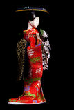 Geisha doll. Japanese doll isolated on black background Royalty Free Stock Photography