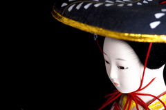 Geisha doll. Japanese geisha doll's face over black background Stock Photography