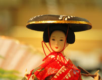 Geisha doll portrait. In front of a souvenir store-location lighting and mood Stock Image