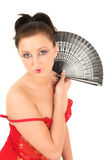 Geisha with fan. Portrait of young geisha girl with fan in her hand Stock Photo