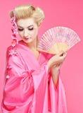 Geisha with a fan. Beautiful geisha with a fan Royalty Free Stock Photography