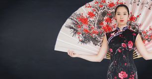 Geisha with giant fan against navy chalkboard Stock Images