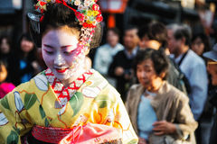 Geisha in Gion. Kyoto, Japan - April 8, 2013: Geisha moving through the crowd in the Gion district of Kyoto.  The Geisha in Gion are the highest ranked in Japan Stock Image