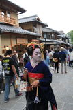 Geisha girl. Japanese geisha girl walking on the street Royalty Free Stock Images