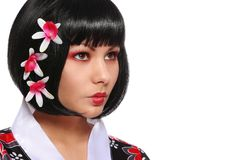 Geisha girl in kimono and beautiful flowers in her black hair. Isolated on white Stock Images
