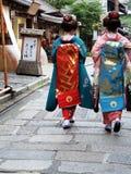 Geisha Girls. Walking down the street Stock Photos