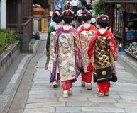 Geisha group in a Kyoto street. A group of one day geisha Japanese girls,walking in a very traditional area of Kyoto City,Japan Royalty Free Stock Images