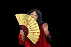 Geisha hiding her face behind fan Royalty Free Stock Photo