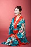 Geisha Japanese woman in kimono and facepaint Royalty Free Stock Photos