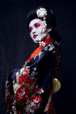 Geisha in kimono on black Royalty Free Stock Photography
