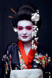 Geisha in kimono on black Royalty Free Stock Images