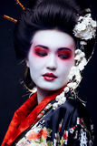 Geisha in kimono on black Royalty Free Stock Photos