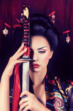 Geisha in kimono with samurai sword Stock Photography