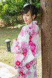 Geisha leaning against wodden pillar Royalty Free Stock Photography