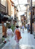 A geisha and a maiko walk down the streets of Miyagawacho neighborhood in Kyoto Stock Photo