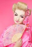 Geisha mit einem Gebläse Stockfotografie