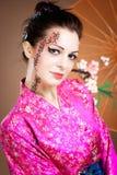 Geisha mit Regenschirm Stockfotos
