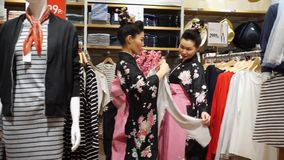 Geisha. Moscow, Russia - March 24, 2017: group of geisha shopping in the UNIQLO clothing store. Performance is timed to the opening of a new Uniqlo store in stock footage