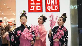 Geisha. Moscow, Russia - March 5, 2017: Three geisha in traditional Japanese kimono with sakura branches at the entrance to the uniqlo store. Performance is stock video footage