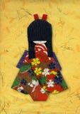 Geisha origami on Yellow. Handmade paper Stock Images