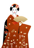 Geisha in red kimono holding a fan Stock Photography