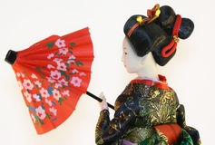 Geisha with red umbrella Royalty Free Stock Photography