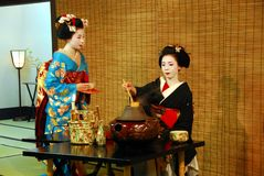 Geisha tea ceremony. Two geisha performing a tea ceremony in Kyoto Royalty Free Stock Images