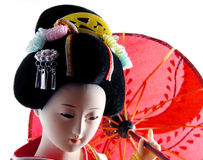 Geisha with umbrella. Geisha doll with umbrella portrait Stock Images