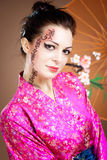 Geisha with umbrella Stock Photos