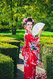 Geisha woman with a fan Stock Images
