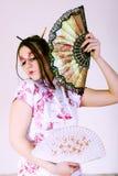Geisha. Woman wearing traditional dress holding th Royalty Free Stock Photos