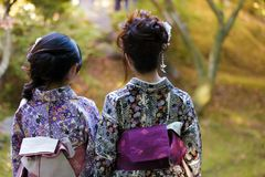 Geishas in a Japanese garden Stock Images