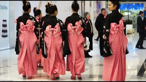 Geishas. Moscow, Russia - March 24, 2017: group of japanese geishas in traditional japanese kimono go away in a mall Rivierra. The performance dedicated to the stock video