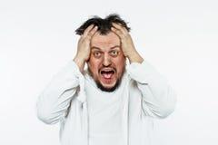 Geisteskranker Mann in der Zwangsjacke Stockbild