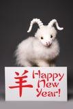 Geit of schapen met de kaart van de Nieuwjaargroet Royalty-vrije Stock Foto's