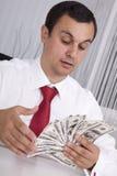 Gek over geld Stock Afbeeldingen